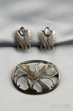 Georg Jensen, Two Sterling Silver Jewelry Items,  a brooch depicting a bird in flight, no. 238, signed G with a J superimposed, and a pair of earstuds, each set with a cabochon moonstone, signed GI Denmark, lg. 1 3/4 and 7/8 in.