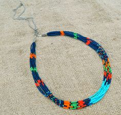 Long seed bead and chain southwest style blue, orange, turquoise, green, and red statement necklace by EntwineArt on Etsy Beaded Jewelry, Beaded Necklace, Seed Bead Projects, Southwest Style, Blue Orange, Fashion Necklace, Seed Beads, Jewelry Ideas, Jewelery