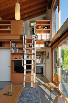 How To Make The Most Out Of Your Small Space #refinery29  http://www.refinery29.com/dwell/12#slide10  A rolling ladder made from salvaged wood and components leads to a small, yet well equipped, office in the 200-by-12-foot backyard pavilion designed by Seattle's Ninebark Design/Build.NEXT: Go Bright — No Matter How Small Your Space Is