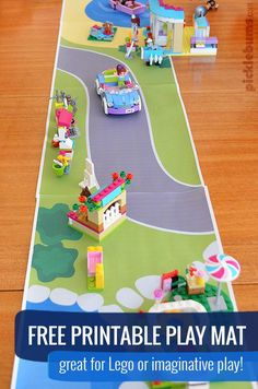 Free Printable Play Mat -  This 4 page printable play mat connects end to end and makes a scene from the sea to the country! Perfect for Lego or imaginative play.