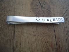 Hey, I found this really awesome Etsy listing at http://www.etsy.com/listing/130888032/mens-personalized-tie-clip-hand-stamped