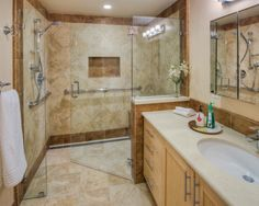 "Large walk in shower w/ wheel chair access too""  ""shower controls near door so you don't get wet."