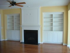 Here is a pair of white, traditional built-in bookshelves designed by Woods Cabinets. Bookshelf Design, Bookshelves, Custom Shelving, Shelving Units, Entertainment Centers, Mantels, Wood Cabinets, Built Ins, Empty