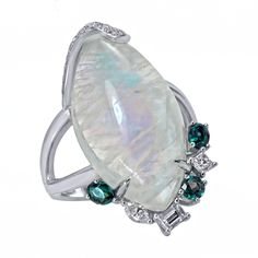 Laura Medine. Crafted in 18kt gold, this ring features a Moonstone and is complemented by an assortment of natural Alexandrites and fancy shape white diamonds