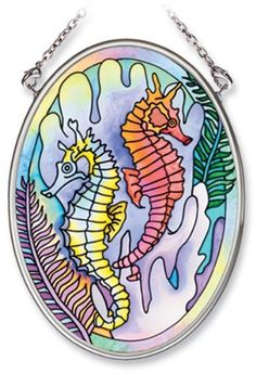 Amia Hand Painted Glass Suncatcher with Seahorse Design, 3-1/4-Inch by 4-1/4-Inch Oval by Amia. $11.00. Handpainted glass. Includes chain. Comes boxed, makes for a great gift. Amia glass is a top selling line of handpainted glass decor. Known for tying in rich colors and excellent designs, Amia has a full line of handpainted glass pieces to satisfy your decor needs. Items in the line range from suncatchers, window decor panels, vases, votives and much more.