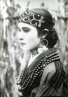 Ainu woman in traditional dress.  Northern Japan