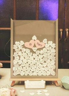 Guest Book idea; A friend of Mike's married over the weekend had a similar guestbook (theirs was nicer). You signed a heart and dropped it in the shadow box frame. So neat!