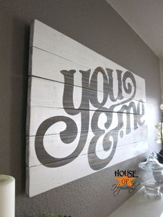DIY wall art. Old pallet planks, sanded, then painted with any phrase! Front entrance Welcome sign?