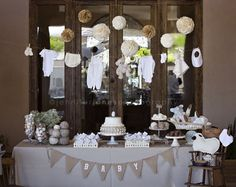 My daughter's gender neutral, vintage lamb themed baby shower featured organic textiles with browns and cremes.