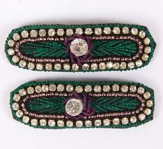 """A beautiful pair of hand embroidered elongated oval shape snap clips-""""tick tock clips"""". Green thread edging with diamonds and purple beading embroidery with one big diamante in the center. Snap clip, diamantes, hand embroidered. Green, Purple, Beading, Diamante, Round Crystal. Rectangle with rounded edges; Approx. 1 1/2 inches length by 1/2 inch width. Unique and beautiful on young girls and adults. £8.00 on Etsy... Please click on the Etsy link to purchase."""