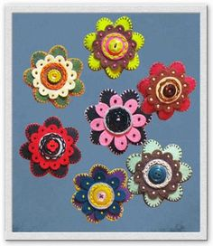 Felt Flowers.  Simple embroidery, add buttons and beads...make them into magnets, for scrapbooking or use your imagination.