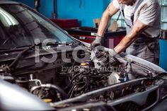Mechanic maintaining car engine royalty-free stock photo