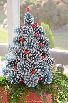 red miniature Christmas ornaments used on a pine cone Christmas tree Pine Cone Christmas Decorations, Pine Cone Christmas Tree, Christmas Centerpieces, Simple Christmas, Christmas Diy, Christmas Wreaths, Christmas Ornaments, Pine Tree, Primitive Christmas