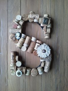 Monogram Cork Letter. Maybe with painted beer caps instead since we don't drink wine?