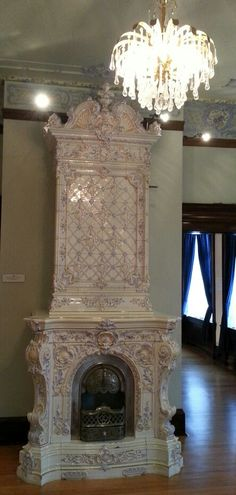Enamel tiled stove American Swedish Institute. The chandelier crystal mimics the lace making spools!