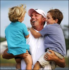 """""""Matt Kuchar celebrates with his two sons, Carson and Cameron, on the 18th green as the new winner of THE PLAYERS Championship. These are moments that I cherish as a photographer -- capturing a dad and his sons celebrating together."""" -- Stan Badz, PGA TOUR Photographer"""