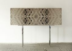 Tina Roeder | Structures/Facades Credenza | 1.5 mm grey cardboard and chrome-plated steel, 2008 | Unique piece (with David Krings)