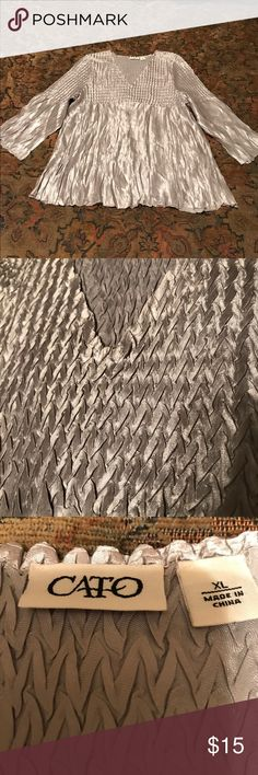 """Cato Silver Party Shirt Beautiful metallic silver shirt stretches for a perfect fit.  Measures 22"""" seam to seam at the bust and is 25"""" long. Cato Tops Blouses"""