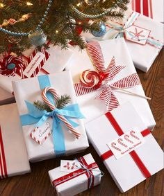 Streamline gift-giving by wrapping all your presents in the same pristine white paper brightened with bold color. It's elegant, economical, and easy to customize with tree cuttings, tags, and tempting candies.  - GoodHousekeeping.com
