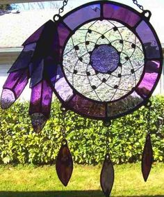 No Link connected to this picture...This is an Original Design of mine. Stained Glass Dreamcatcher with Arched Wire Web. The web is arched and inch or more above an iridescent granite textured glass. The solder was given a copper patina. Currently not taking any orders due to health Issues.