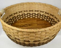 Large Round Handmade Tray Basket using Reed, Wood Base, and Pottery Handles in Shades of Brown
