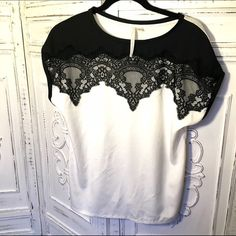 White with Black Lace Top by LC Lauren Conrad White and Black lace top. The front is a soft silk like poly with the eyelash lace details. The back is cotton. Great with jeans and skirts! LC Lauren Conrad Tops Tees - Short Sleeve