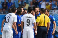 Gianluigi Buffon of Italy  appeals to referee Marco Rodriguez after Claudio Marchisio is sent off during the 2014 FIFA World Cup Brazil Grou...