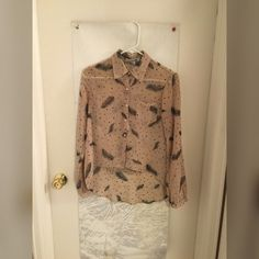 Flowy sheer button up shirt Flowy button up sheer shirt with feather pattern Forever 21 Tops Button Down Shirts