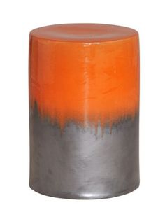 Two-Tone Garden Stool in Burnt Orange from Emissary features gloss and matte finished ceramic. Bold, bright color cascades down sultry silver to create decadent seating for indoor or outdoor use.