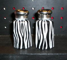 Zebra print salt/pepper shakers. Would look cute in a red kitchen.