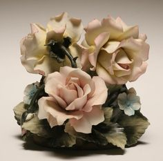 Handcrafted in soft porceline, very fragine flowers, madethe same way for100's of years  is called capodimonte