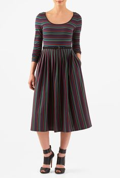 Our stripe cotton jersey knit dress is styled with a belted waist nipping in the seamed waist and a knife-pleat full skirt.