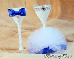 This beautiful handmade set of two champagne glasses are decorated with ribbon, tulle and rhinestones. Its elegant and impession detail for your
