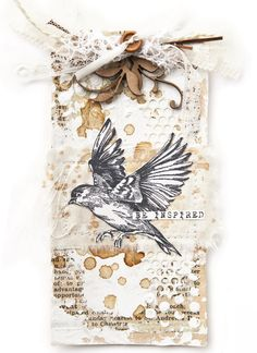 DeeDee Catron incorporated wooden embellishments and scraps of drywall tape into this card from The Stampers' Sampler.