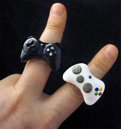 Playstation and Xbox game controller rings. The Playstation one would be SO cool; I've had all three Playstation Consoles and have loved them all!