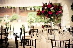 Les Fleurs tent weddings summer with tall centerpeices