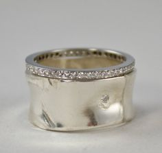 Strikingly Bold and Splendidly Simple packing a soulful message of self acceptance. Wide silver band with one small diamond. Perfectly imperfect, Beauty in Imperfection. Beauty in Imperfection jewelry