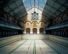"""England, Manchester, Manchester Baths, - opened in 1906, closed in 1993. Edwardian-era styling. No expense was spared as at the time of construction, Manchester had one of the wealthiest municipal coffers in the world, and the city's newest """"cathedral of swimming"""" was as extravagant as it was functional."""