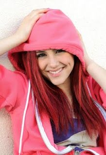 Ariana Grande xx I can picture myself like this... In my fave pink hoodie with bright red hair laughing at one of my friends jokes