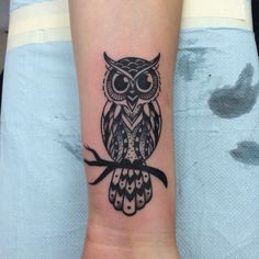 This is my owl tattoo done in all black with shading and dot work located on my wrist