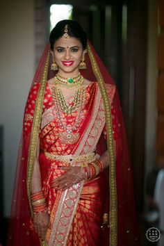 Looking for South Indian bridal look in red saree with dupatta? Browse of latest bridal photos, lehenga & jewelry designs, decor ideas, etc. on WedMeGood Gallery.