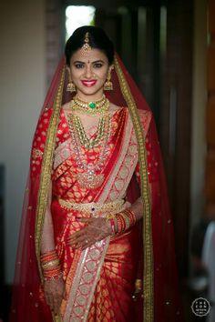 Beautiful bridal red saree with traditional jewellery on wedding day |WedMeGood| Pooja & Vivek|#wedmegood #indianweddings #traditional #bridalshot #bridalportrait #bridals #jewellery #saree #red #southindian