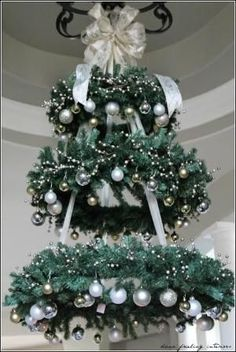 Hanging Christmas Tree - WREATH CHANDELIER ~ This would be so pretty in the entryway! this would make a very pretty outdoor tree for our porch Christmas Decor Diy Cheap, Hanging Christmas Tree, Decoration Christmas, Noel Christmas, Winter Christmas, Christmas Wreaths, Christmas Ornaments, Holiday Decor, Gold Ornaments