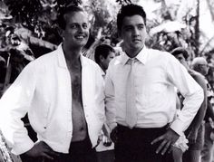 Elvis and Tom Moffat between takes on the Blue Hawaii set in april 1961.