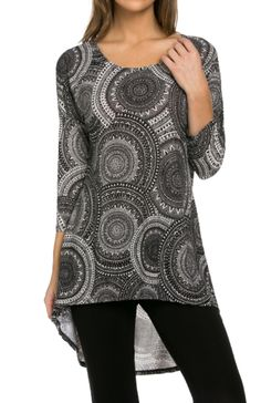 - Juniors Sizing - 95%Polyester 5%Spandex - MADE IN USA - This cool and comfortable knit top features a scoop neckline, 3/4 length dolman sleeves, relaxed fit, and hi-low hemline. - Our 3/4 Sleeve Mix