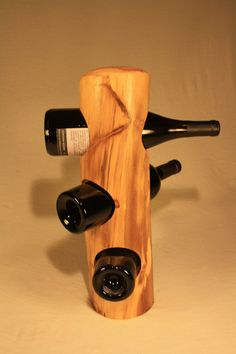 Great use for reclaimed wood - turn an old stump into a wine rack!