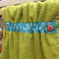 Dish towel made by onegroovyday. She used elastic and buttons instead of ribbon.