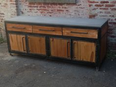 custom reclaimed wood, metal, and concrete cabinet by naan industries