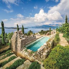 Architect Antonio Zaninovic, designer Lucien Rees-Roberts, and landscape architect David Kelly repurposed 15th-century Croatian ruins into a contemporary retreat, complete with a breathtaking pool with unrivaled views of the Adriatic Sea. : Scott Frances, courtesy of Otto. #architecture #pool #adriaticsea #croatia #design #landscape