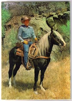 Rex Allen-the best singing cowboy!  Astride his beautiful horse, KoKo.